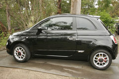 Fiat 500 Black Beauty. A new compact car in the driveway of my house in Sydney Australia Stock Photos