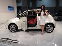 Fiat 500 and Italian Model. Photo of fiat 500 and italian model at the washington dc auto show on 1/29/10.  The fiat 500 is one of europe's most popular cars and Stock Photo