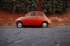 A Fiat 500 parked in Rome, Italy.