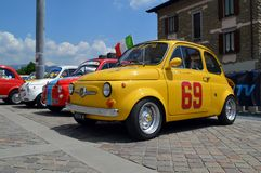 FIAT 500 Abarth. A yellow FIAT 500 Abarth at Clusone for a rally dedicated to the small italian citycar. Derived from the wide known citycar, this sporty version Stock Photography