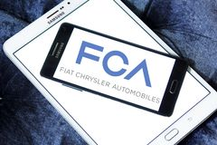 Fiat Chrysler Automobiles, FCA company logo. Logo of Fiat Chrysler Automobiles, FCA company on samsung mobile. FCA is an Italian-controlled multinational stock image