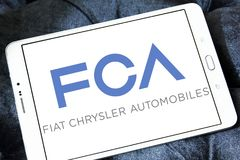 Fiat Chrysler Automobiles, FCA company logo. Logo of Fiat Chrysler Automobiles, FCA company on samsung tablet . FCA is an Italian-controlled multinational stock image