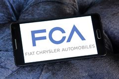 Fiat Chrysler Automobiles, FCA company logo. Logo of Fiat Chrysler Automobiles, FCA company on samsung mobile. FCA is an Italian-controlled multinational stock photography