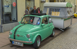 Fiat 500 - Cinquecento, classic car with camper. The Fiat 500 Italian: Cinquecento, is a rear-engine, two-door, four passenger, city car manufactured and Royalty Free Stock Photography