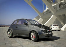 Fiat 500 city car, outside of modern industrial building environment. Fiat 500 city car, outside of a modern industrial building environment, in daylight Stock Photos