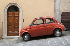 FIAT 500 classic car. A classic FIAT 500 car parked on a street in Montepulciano, Tuscany Italy Royalty Free Stock Images