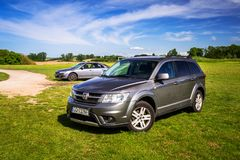 Fiat Freemont SUV parked on the grass. Poland - May 19, 2018:  Fiat Freemont SUV parked on the grass, Poland. Fiat Freemont is an european version of Dodge Royalty Free Stock Image