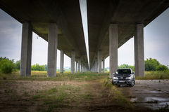 Fiat Freemont SUV under the highway overpass in Poland Royalty Free Stock Images
