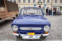 Fiat 850, front view, retro design car. Exhibition of vintage ca. Rs. Rally of old vintage vehicles anciens. Dark blue color with chrome lights Stock Photography