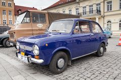 Fiat 850, front view, retro design car. Exhibition of vintage ca. Rs. Rally of old vintage vehicles anciens. Dark blue color with chrome lights Royalty Free Stock Images