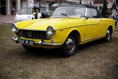 Fiat 1500. Front view of yellow classic vintage car Fiat 1500 coupe cabriolet 1965 at Le Touquet France vintage car owner exhibition royalty free stock photo