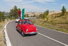 Fiat 500  with Italian flag Royalty Free Stock Photos