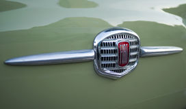 FIAT logo on Classic car. Milan, Italy - February 20, 2016: Close up detail of FIAT logo on vintage car Royalty Free Stock Photo