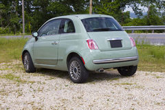2013 Fiat 500. Mint Green, 2013 Fiat 500 two door sedan parked beside of the road in Eureka Springs, Arkansas.  Rear and side view Stock Photo