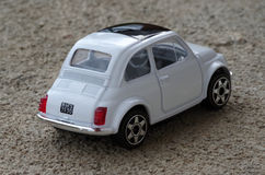 Fiat 500. A model of italian car Fiat 500 from behind Stock Images