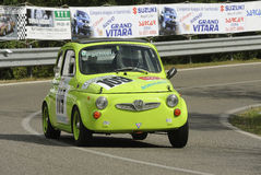 Fiat Nuova 500 Steyr-Puch. A Fiat Ritmo Abarth attends the 33th edition of Coppa del Chianti Classico  a competition race of hill-climb for Historical cars valid Stock Image
