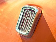 Fiat old logo. In the hood of a car Royalty Free Stock Image