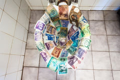 World Currencies Obsolete Toilet Royalty Free Stock Image