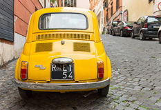 Fiat 500 parked in Rome Royalty Free Stock Photography