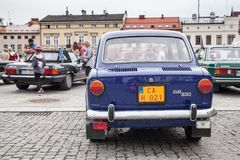 Fiat 850, rear view, retro design car. Exhibition of vintage car. S. Rally of old vintage vehicles anciens. Dark blue color with chrome lights Stock Photo