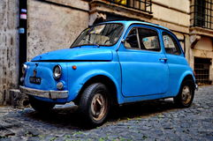 A Fiat 500 on September 20, 2013 in Rome. ROME - SEPTEMBER 20: A Fiat 500 on September 20, 2013 in Rome. Fiat 500 was produced by the Fiat company from 1957 to Royalty Free Stock Photos