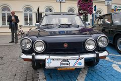 Fiat Sport 750, front view, retro design car. Exhibition of vint. Age cars. Rally of old vintage vehicles anciens. Dark blue color with chrome lights Stock Images