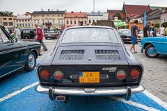 Fiat Sport 750, rear view, retro design car. Exhibition of vinta. Ge cars. Rally of old vintage vehicles anciens. Dark blue color with chrome lights Royalty Free Stock Photos