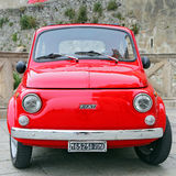 Fiat 500 on the street in the center of Gaeta. GAETA, ITALY - JUNE 25, 2016: Fiat 500 on the street in the center of Gaeta. Fiat 500 was produced by the Fiat Stock Photography