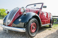 Fiat topolino car. VERONA, ITALY - SEPTEMBER 27: Topolino car. Topolino Autoclub Italia organizes a gathering on Lake Garda Sunday, September 27, 2014. Cars and Royalty Free Stock Image