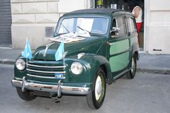 Fiat 500 Topolino. Fiat 500 green parked on the street Royalty Free Stock Images