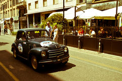 Fiat Topolino at Mille Miglia 2016. A Fiat 500C Topolino 1950 passing through Tasso street Bergamo, Italy before the crowd during the 2016 Mille Miglia classic Royalty Free Stock Images