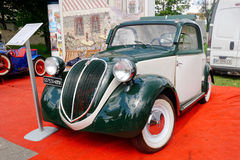 Fiat Topolino vintage car - Stock image. Kharkiv, Ukraine - May 22, 2016: Retro car green Fiat Topolino manufactured between 1936 and 1955 is presented at the Stock Photography