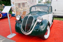 Fiat Topolino vintage car - Stock image. Kharkiv, Ukraine - May 22, 2016: Retro car green Fiat Topolino manufactured between 1936 and 1955 is presented at the Stock Photo