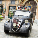 Fiat Topolino with wine demijohns Stock Photography