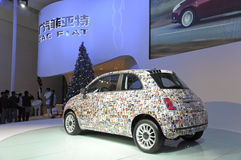 FIAT500. Italy mini car FIAT500 in its exhibition hall,in 2010 international Auto-show GuangZhou. it is from 20/12/2010 to 27/12/2010. photo taken on 25 Dec Royalty Free Stock Photos