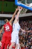 [FIBA Eurochallenge] BC Mures - Szolnoki Olaj. Aleksandar Mladenovic (right) scores two points against Chris Oliver (left) in the first leg of Group H's 2013/ royalty free stock photos