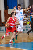 [FIBA Eurochallenge] BC Mures - Szolnoki Olaj. Balazs Simon (left) drives the ball against Dan Paltinisanu (right) in the first leg of Group H's 2013/2014 FIBA Royalty Free Stock Image