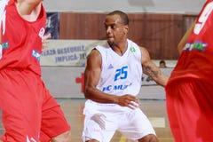 [FIBA Eurochallenge] BC Mures - Szolnoki Olaj. Tyronn Mitchell drives the ball in the first leg of Group H's 2013/2014 FIBA Euro Challenge cup game between BC stock photos