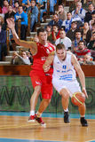 [FIBA Eurochallenge] BC Mures - Szolnoki Olaj. Vaidotas Peciukas (right) drives the ball against Balazs Simon  in the first leg of Group H's 2013/2014 FIBA Euro Stock Image