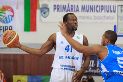FIBA EuroChallenge :: BC Mures vs Rilski Sportist. Denham Brown is guarded by Sean Barnette in the FIBA EuroChallenge game between BC Mures from Romania and royalty free stock image