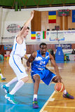 FIBA EuroChallenge :: BC Mures vs Rilski Sportist. Evan Ravenel is defended by Dan Paltinisanu in the FIBA EuroChallenge game between BC Mures from Romania and royalty free stock photos