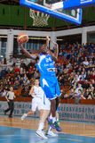 FIBA EuroChallenge :: BC Mures vs Rilski Sportist. Evan Ravenel tries to score two points in the FIBA EuroChallenge game between BC Mures from Romania and Rilski royalty free stock photography