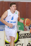 FIBA EuroChallenge :: BC Mures vs Rilski Sportist. Silviu Lupusavei drives the ball in the FIBA EuroChallenge game between BC Mures from Romania and Rilski stock image