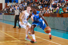 FIBA EuroChallenge :: BC Mures vs Rilski Sportist. Vernon Taylor drives the ball against Silviu Lupusavei in the FIBA EuroChallenge game between BC Mures from royalty free stock photography
