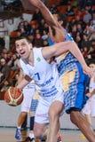 FIBA EuroChallenge :: BC Mures vs Tsmoki Minsk. Aleksandar Mladenovic tries to escape Keith Benson's defense in the FIBA Eurochallenge game between BC Mures and Stock Image