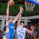 FIBA EuroChallenge :: BC Mures vs Tsmoki Minsk. Aliaksei Lashkevich tries to score 2 points against Aleksandar Mladenovic in the FIBA Eurochallenge game between Stock Photography