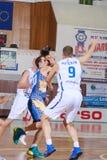 FIBA EuroChallenge :: BC Mures vs Tsmoki Minsk. Branko Mirkovic is defended by Ivan Ivanovic and Vaidotas Peciukas in the FIBA Eurochallenge game between BC Royalty Free Stock Photo