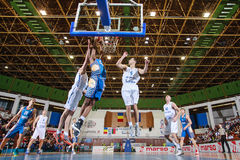 FIBA EuroChallenge :: BC Mures vs Tsmoki Minsk. Demonte Harper tries to score 2 points against Aleksandar Mladenovic (left) and Goran Martinic (right) in the Stock Images