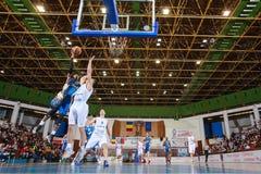 FIBA EuroChallenge :: BC Mures vs Tsmoki Minsk. Demonte Harper tries to score 2 points against Goran Martinic in the FIBA Eurochallenge game between BC Mures and Royalty Free Stock Photography