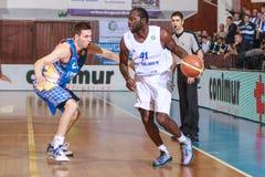 FIBA EuroChallenge :: BC Mures vs Tsmoki Minsk. Denham Brown drives the ball against Vitali Liutych in the FIBA Eurochallenge game between BC Mures and Tsmoki Stock Images